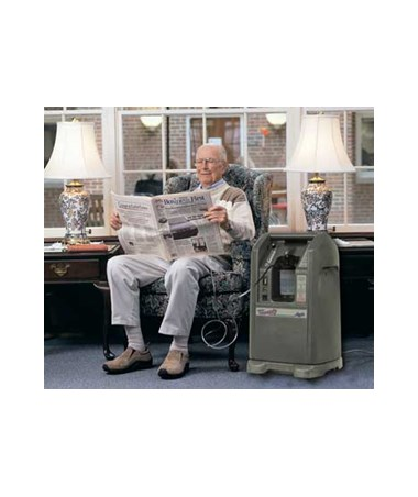 CHRAS099-4U - Refurbished NewLife Intensity 10 Stationary Oxygen Concentrator - Dual Flow - in use